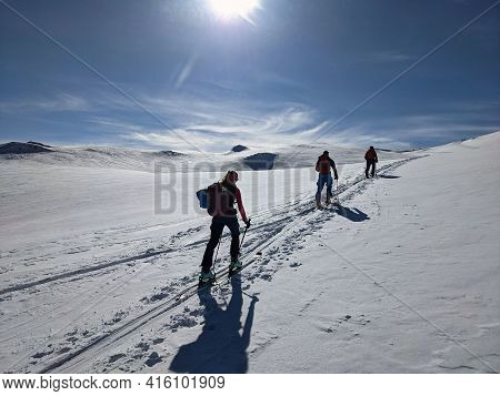 Hiking On Skis On The Great Swiss Mountains. Fantastic View In Winter Time. Ski Touring Couple. Ski
