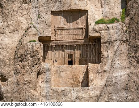 Sandstone Rock With Carved Tombs Of Persian Kings In Necropolis, Iran. King Burial Site Of Ancient P