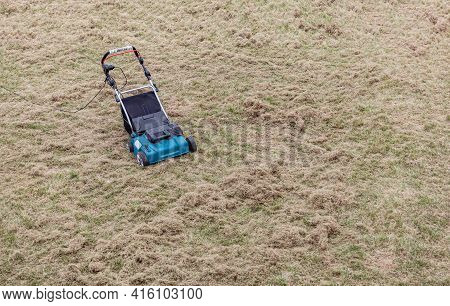 Scarifying Lawn With A Scarifier, Scarifies The Lawn And Removal Of Old Grass