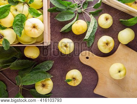 Top View. Fruit Harvest. Fresh Juicy Apples With Leaves In A Wooden Box On A Dark Background