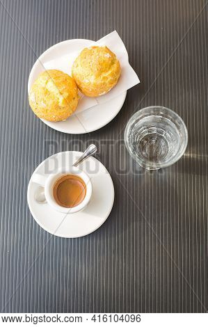 Coffee Couple With Hot Fresh Espresso, Two Round Cakes And Glass Of Still Water On Grey Surface. Ver
