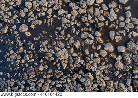 Rubble On The Melted Snow, Floods. The Texture Of The Stones. Background. Rubble For Construction. T
