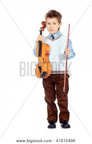 Portrait of a boy posing with his violin. Isolated over white background.