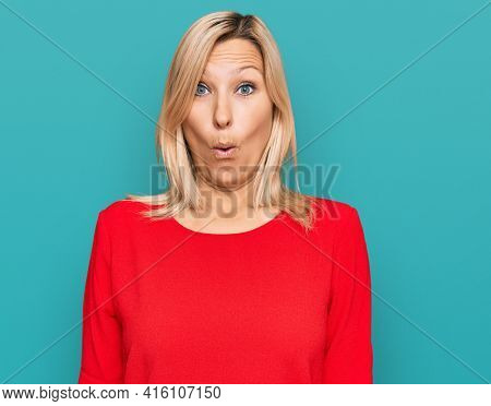 Middle age caucasian woman wearing casual clothes afraid and shocked with surprise expression, fear and excited face.