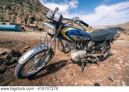 Shiraz, Iran - 04.09.2019: An Old Motocycle In A Nomad Camp Near Shiraz, Fars Province, Iran, Persia
