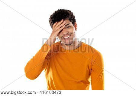 Young african american black man laughing out loud at some hilarious joke, feeling happy and cheerful, having fun isolated on a white background