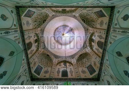 Mahan, Iran - 04.10.2019: Ceiling Of The Dome Of Shah Nematollah Vali Shrine. Interior Of A Sufist M