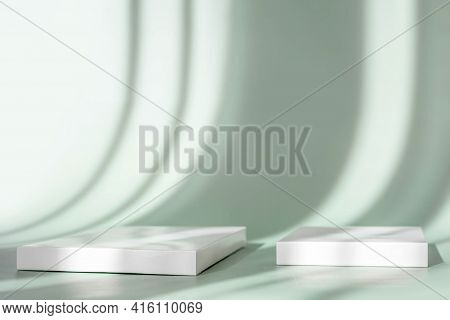 Two Abstract Empty White Podium On Pastel Background With Shadow. Mock Up Stand For Product Presenta