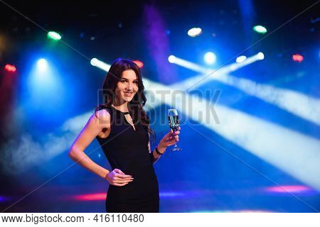 Holidays, Nightlife, Drinks, People And Luxury Concept - Beautiful Young Woman Drinking Champagne At
