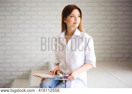 Concept Artist Beautiful Girl. Beautiful Women Are Creating Art. Young Artist Painting In The House