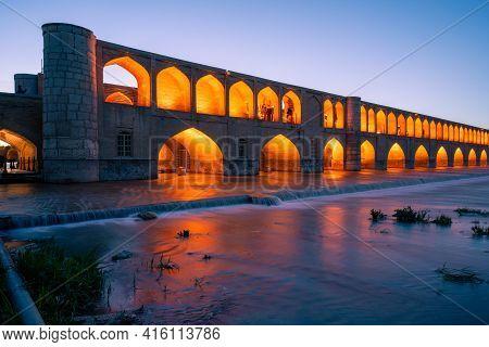 Isfahan, Iran - 14.04.2019: Nightfall At The Si O Se Pol Bridge, Isfahan, Iran. Orange Lights On The