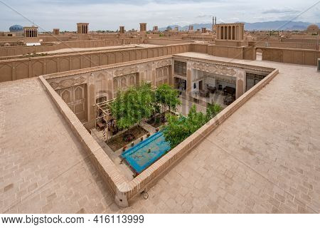 Yazd, Iran - 14.04.2019: Rooftops Of Historical Ciry Of Yazd, Iran. Small Patio Garden In The Front.
