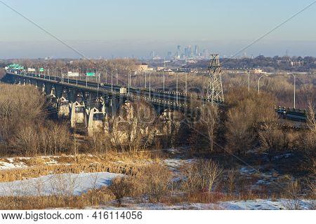 Landmark Mendota Bridge Spanning Minnesota River And Minneapolis Skyline