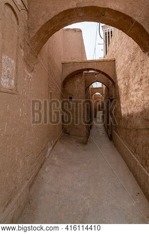 Narrow Streets Of The Historical Center Of Yazd, Iran. Mud Bricks And Arches. Medieval Quarters. Ira