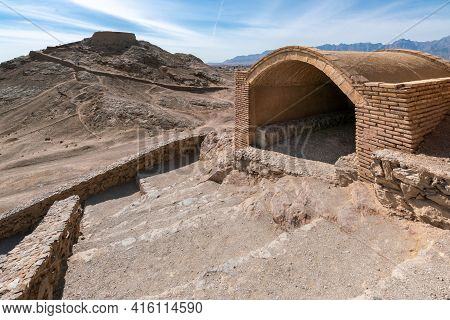 Zoroastrian Tower Of Silence With Stairs And Tomb In The Foreground, City Of Yazd, Iran. Ancient Per