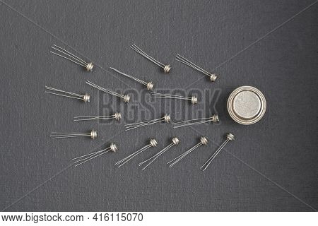 Old Many Soviet Transistors In Metal Case On Black Background. Electronic Component Transistors Look