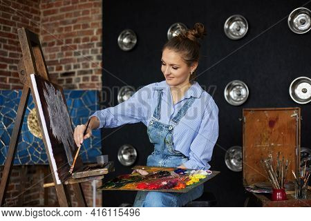 Young Beautiful Female Artist Painting Still Life With Sunflower On Canvas Using Oil Paintings And A