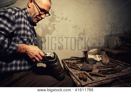 cobbler at work with old tools poster