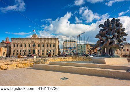 Valetta, Malta - January 11, 2019: Beautiful architecture of the Auberge de Castille in Valletta, the capital of Malta.