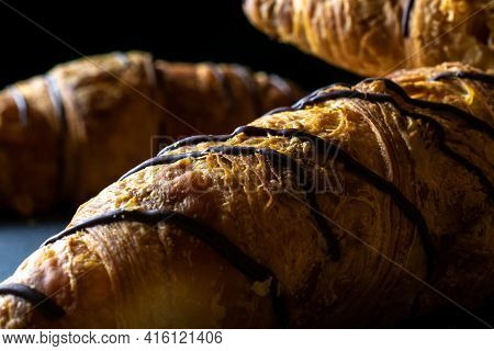 Croissant Texture. French Breakfast Croissants, Fresh Pastry Bread With Chocolate In Bakery On Dark