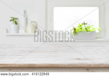 Wooden Tabletop With Copy Space Over Blur Kitchen Window Background