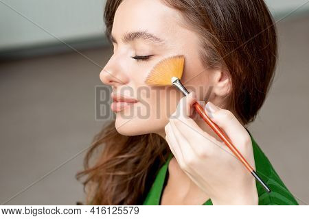 Makeup Artist Dry Cosmetic Tonal Foundation On The Face Using Make Up Brush, Beauty With Perfect Nat