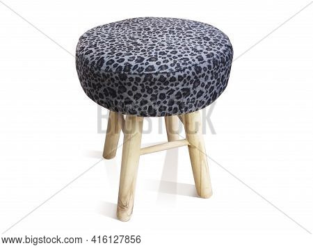Round Stool With Wooden Legs And Seat Covered With Gray Ethnic Fabric Isolated On White Background.