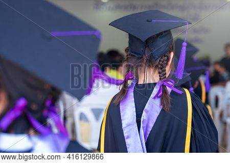 Closeup Of Diploma Graduating Little Student Kid In School