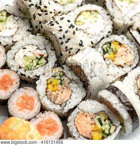 Sushi Tuna Rolls Decorated With Sesame Seeds And Masago Or Tobiko Caviar. Inside-out Sushi Set. Diff