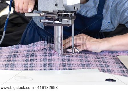 Knitwear Cutter, Sewing A Production Fabric Cage