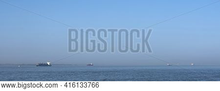 Many Ships On Westerschelde On Sunny Day Near Vlissingen In Holland Between Antwerp And North Sea