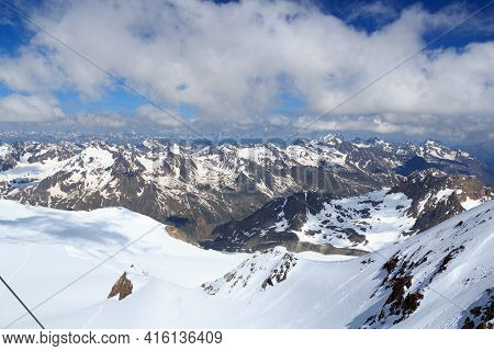 Mountain Snow Panorama On Main Chain Of The Alps Seen From Summit Wildspitze And Blue Sky In Tyrol A