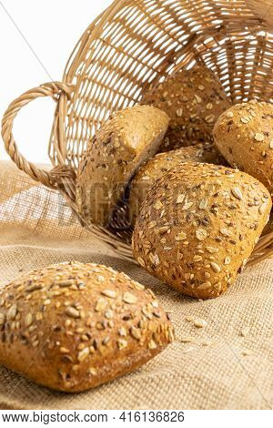 Sliced Multigrain. Rye Bakery With Crusty Loaves And Crumbs. Fresh Loaf Of Rustic Traditional Bread