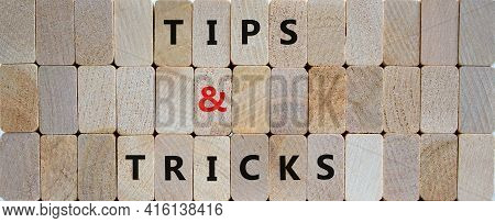 Tips And Tricks Symbol. Wooden Blocks With Words 'tips And Tricks'. Beautiful Wooden Background. Bus