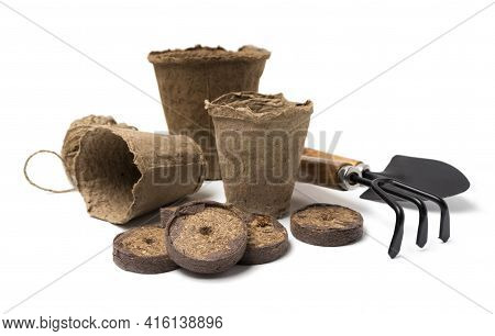 Biodegradable Peat Pots, Peat Tablets, Garden Tools And Rope Isolated On White Background. Spring Ga