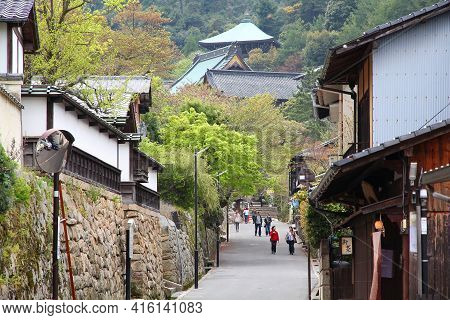 Miyajima, Japan - April 21, 2012: People Visit Old Town In Miyajima (itsukushima) Island In Hiroshim