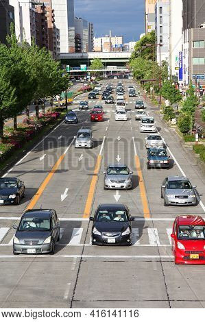 Nagoya, Japan - May 3, 2012: People Drive In Traffic In Nagoya, Japan. With 589 Vehicles Per Capita,