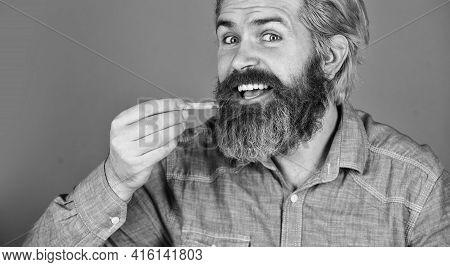 French Fries At The Street Food Market. Bearded Guy Having Snack. Lazy Man Enjoying Junk Food. Man W
