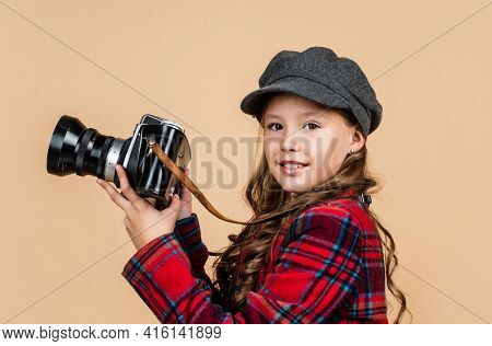 Cheerful Child In Headwear And Checkered Jacket Use Vintage Camera, Retro Photographing