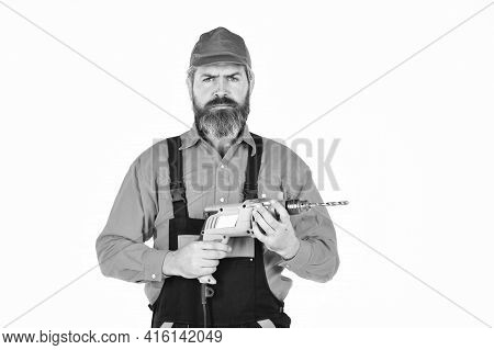 How To Drill Wall Without Hitting Something. Man In Cap With Drills White Background. Builder Repair