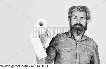 Softness Strength And Absorbency. Prevent Toilet Paper Hoarding. Man Hold Toilet Paper. Hipster With