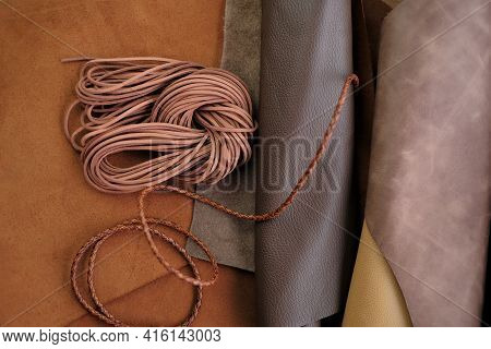 Leather Cord On Natural Brown Leather Background. Accessories Made Of Leather And Leather Cords.leat