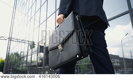 Cropped View Of Businessman Walking With Leather Briefcase.