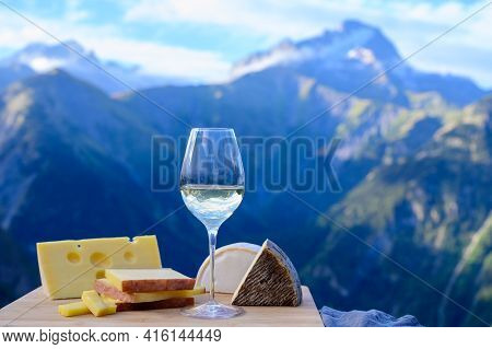 Tasty Cheese And Wine From Savoy Region In France, Beaufort, Abondance, Emmental, Tomme And Reblocho