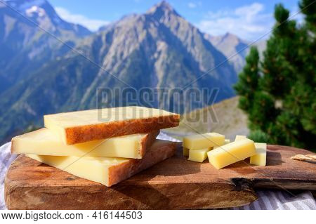 Cheese Collection, French Comte, Beaufort Or Abondance Cow Milk Cheese Served Outdoor With Alps Moun