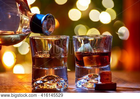 Glasses Of Scotch Whisky Served In Bar In Edinburgh, Scotland, Uk And Pasry Lights On Background