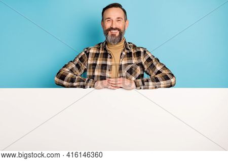 Photo Of Bearded Promoter Man White Wall Empty Space Wear Plaid Shirt Turtleneck Isolated Blue Backg