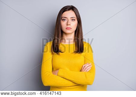 Portrait Of Strict Brunette Nice Lady Crossed Arms Wear Yellow Sweater Isolated On Grey Color Backgr