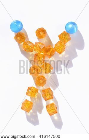Isolated Figure Of A Boxer Winner With Gloves Raised Up Made Of Beads On A White Background. Boxer C