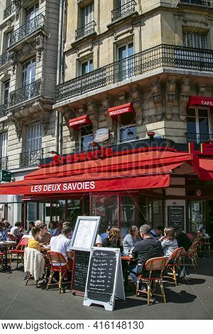 France, Paris, May, 2015 - Parisians And Tourists Dine On The Outdoor Terraces Of Cafes And Restaura
